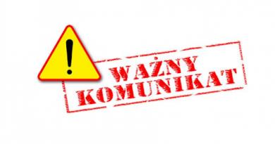 czerwony napis na białym tle - obok trójkąt ostrzegawczy