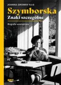 Zdjęcie okładki książki: Pisarka siedząca za stołem w kawiarni.